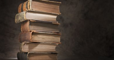 books-books-books-knowledge-table-stack-vintage-luxury-folios-teaching-light-and-ignorance-is-darkness-blur-bokeh-close-up-grey-background-wallpaper